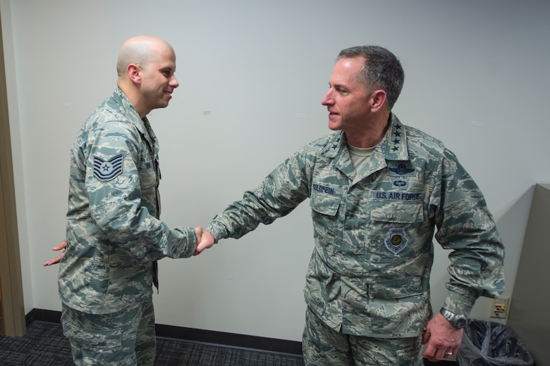 Air Force Vice Chief of Staff Gen. David L. Goldfein presents his coin to Technical Sgt. Adam Vera, a cyber-operator assigned to the 91st Cyber Operations Squadron during a visit at Joint Base San Antonio, Texas March 3. Goldfein also received briefings focused on 24th Air Force – AFCYBER's command and control of cyber forces and took the opportunity to personally thank the cyber warriors as well as to stress the significance of cyber in today's multi-domain operations. (U.S. Air Force photo by MSgt Luke P. Thelen/Released)