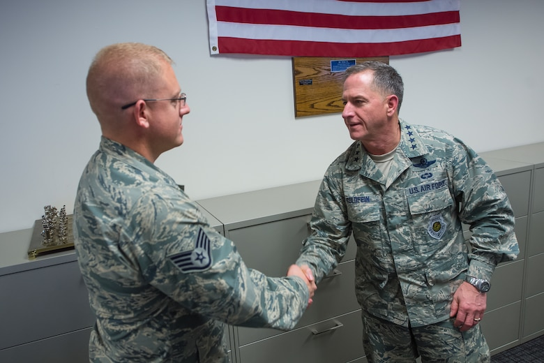 Air Force Vice Chief of Staff Gen. David L. Goldfein presents his coin to Staff Sgt. Benjamin Kenyon, Noncommissioned Officer in Charge of Training, 854th Cyber Operations Squadron during a visit at Joint Base San Antonio, Texas March 3. Goldfein also received briefings focused on 24th Air Force – AFCYBER's command and control of cyber forces and took the opportunity to personally thank the cyber warriors as well as to stress the significance of cyber in today's multi-domain operations. (U.S. Air Force photo by MSgt Luke P. Thelen/Released)