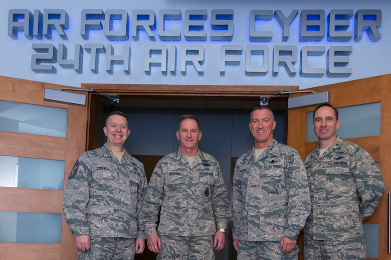 Air Force Vice Chief of Staff Gen. David L. Goldfein (center) poses with senior leaders from 24th Air Force (24AF) – Air Forces Cyber Command (AFCYBER) during a visit at Joint Base San Antonio, Texas March 3. With Goldfein is Command Chief Master Sgt. Brendan Criswell (left), Maj. Gen. Ed Wilson, 24AF - AFCYBER Commander, and Brig. Gen Thomas E. Murphy, 24AF – AFCYBER vice commander (right). (U.S. Air Force photo by MSgt Luke P. Thelen/Released)