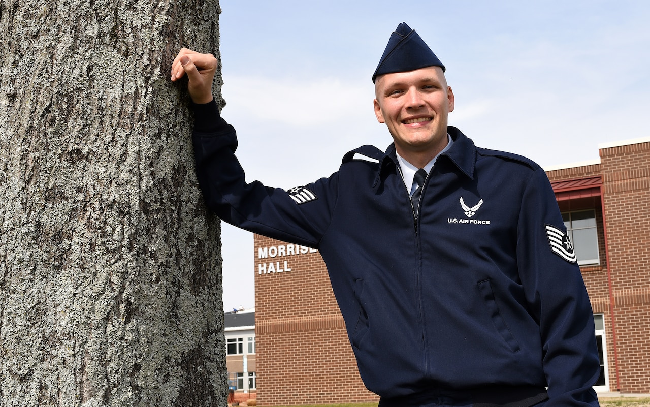 Air Force Tech. Sgt. John C. McClean stops outside the Morrisey Hall classroom building at McGhee Tyson Air National Guard Base, Tenn., while on his way to teach Air Force enlisted professional military education. McClean is a regular Air Force chaplain assistant assigned as an instructor to the Paul H. Lankford Enlisted PME Center. Air Force photo by Master Sgt. Mike R. Smith