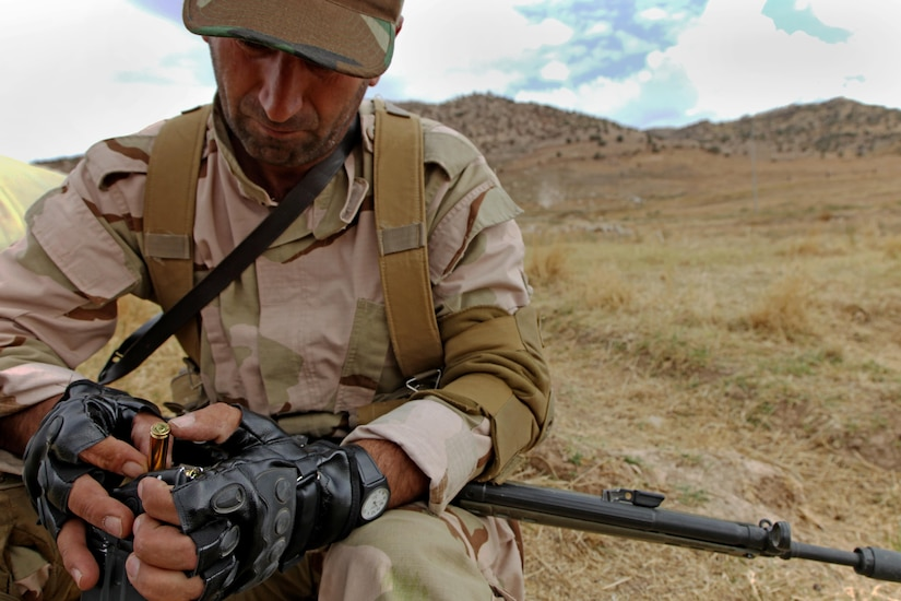 Peshmerga soldier loads ammunition into magazine in preparation for squad-based training near Erbil, Iraq, October 14, 2015, as part of Combined Joint Task Force–Operation Inherent Resolve (U.S. Army/Tristan Bolden)