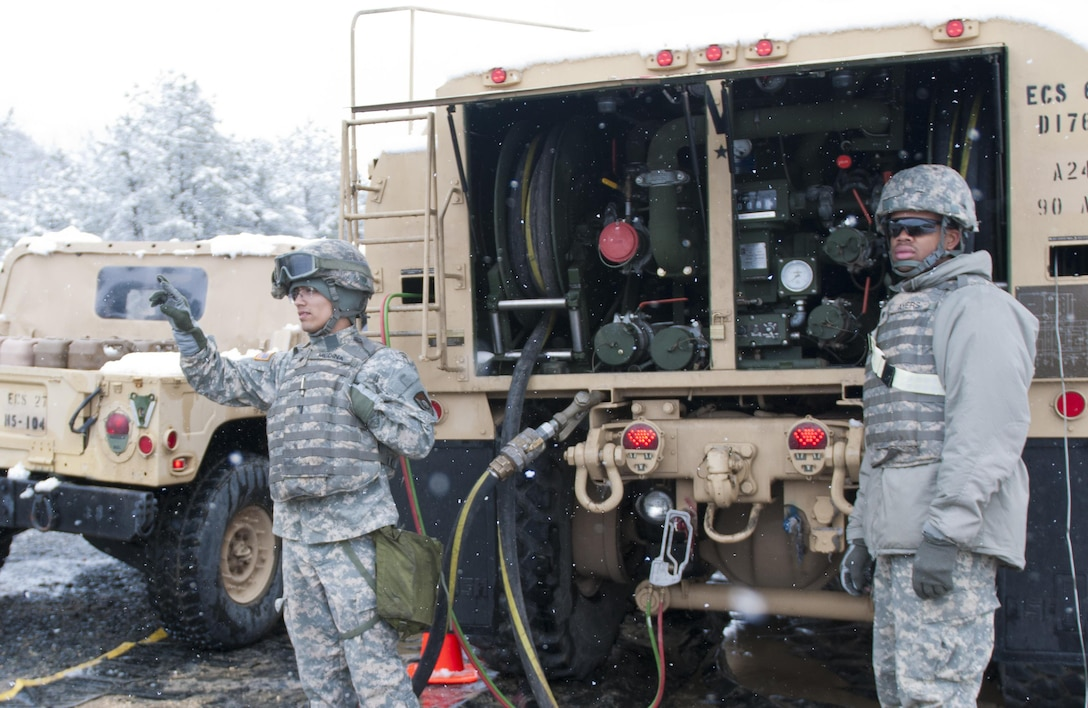 Spc. Alexander Medina (left) and Spc. Phillip Ayers (right), of the 957th Quartermaster Company (Petroleum Supply), wave on-coming Humvees to their fuel point during Combat Support Training Exercise 78-16-01 at Joint Base McGuire-Dix-Lakehurst, N.J., March 04, 2016. CSTX 78-16-01 is a U.S. Army Reserve exercise conducted at multiple locations across the country designed to challenge combat support units and Soldiers to improve and sustain skills necessary during a deployment. (U.S. Army photo by Staff Sgt. Dalton Smith/Released)