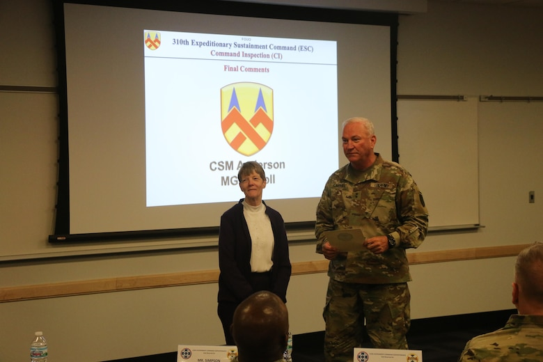 "Maj. Gen. Leslie Carroll (right), the commanding general for the 377th Theater Sustainment Command presents a length of service certificate and emblem to Margaret ""Peggy"" Ranschaert in honor of her 45-year career of service as an Army civilian employee during a length of service ceremony held March 4 at the Spc. Luke P. Frist Army Reserve Center at Fort Benjamin Harrison, Ind."