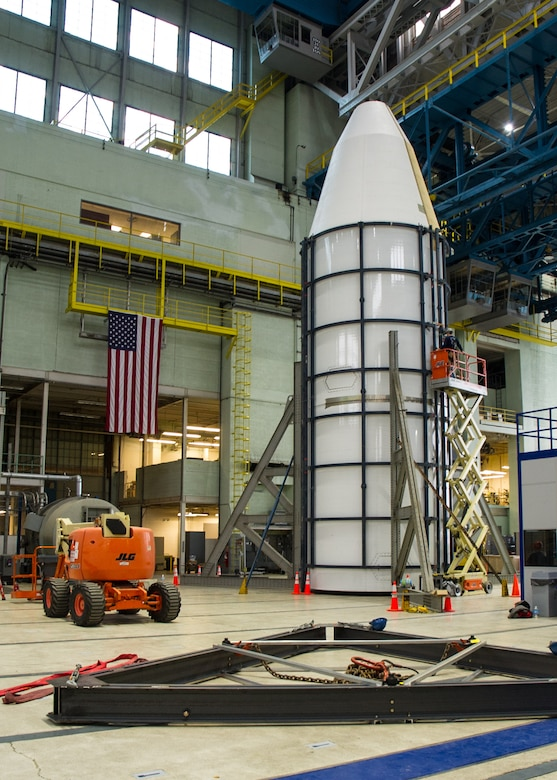 DAYTON, Ohio - Air Force Research Laboratory engineers and technicians from the Structural Validation Branch of the Aerospace Vehicles Division, Aerospace Systems Directorate, partnered with museum restoration crews to assemble a 60 foot tall payload fairing from the Titan IVB space launch vehicle between  Feb. 29-March 2, 2016. The impressive Titan IVB, with roots going back to the early days of U.S. Air Force and civil space launch, is significant as the museum looks to share the story of USAF and USAF-enabled space operations in its Space Gallery. The Titan IVB will be on display in the new fourth building at the National Museum of the U.S. Air Force which opens to the public on June 8. (U.S. Air Force photo by Ken LaRock)