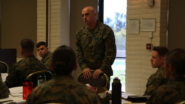 U.S. Marine Brig. Gen. David A. Ottignon listens intently to a student's question at the 1st Marine Logistics Group lieutenant seminar aboard Camp Pendleton, Calif., Feb. 25, 2016. Ottignon is the commanding general of 1st MLG. This seminar among first and second lieutenants in the Group was designed to garner knowledge and foster the camaraderie within the ranks, forming confident and decisive leaders. The seminar had two sessions in February and will continue at least bi-annually. (U.S. Marine Corps photo by 1st Lt. Allison Burgos/Released)