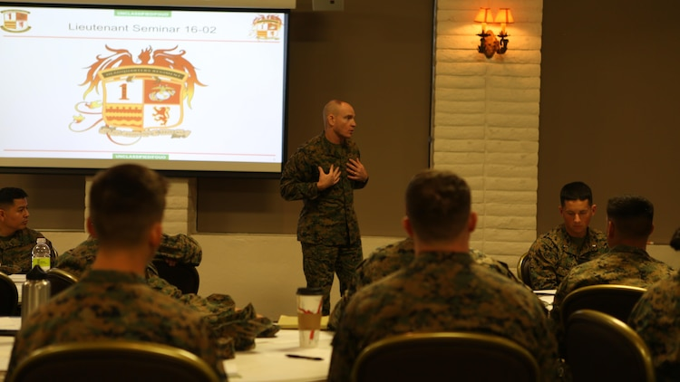 U.S. Marine Sgt. Maj. Troy E. Black speaks to lieutenants at the 1st Marine Logistics Group lieutenant seminar aboard Camp Pendleton, Calif., Feb. 25, 2016. Black is the sergeant major of 1st MLG. This seminar among first and second lieutenants in the Group was designed to garner knowledge and foster the camaraderie within the ranks, forming confident and decisive leaders. The seminar had two sessions in February and will continue at least bi-annually. (U.S. Marine Corps photo by 1st Lt. Allison Burgos/Released)