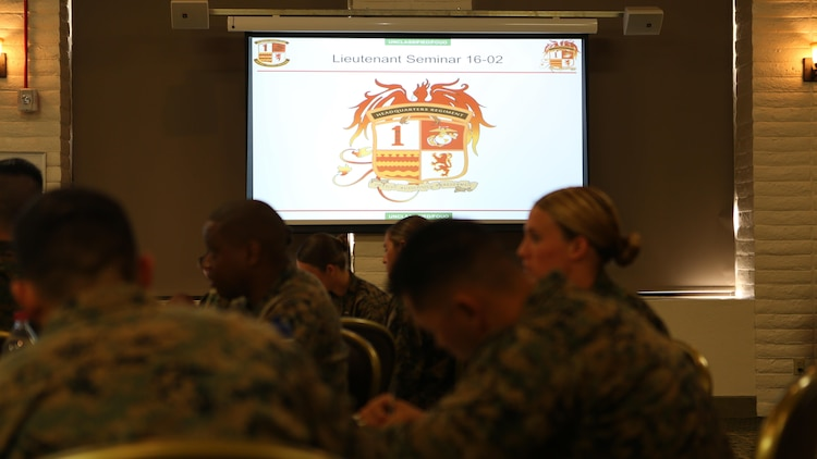 Students listen to remarks from an instructor during the 1st Marine Logistics Group lieutenant seminar aboard Camp Pendleton, Calif., Feb. 25, 2016. This seminar among first and second lieutenants in the Group was designed to garner knowledge and foster the camaraderie within the ranks, forming confident and decisive leaders. The seminar had two sessions in February and will continue at least bi-annually. (U.S. Marine Corps photo by 1st Lt. Allison Burgos/Released)