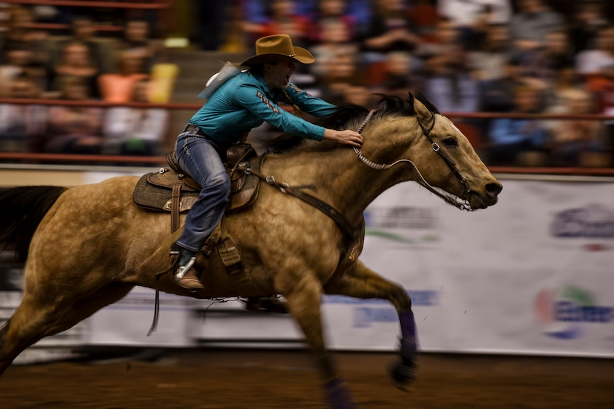 Callie duPerier rides her horse during the barrel racing competition as part of the 84th annual San Angelo Stock Show and Rodeo at Foster Communications Coliseum in San Angelo, Texas, Feb. 17, 2016. duPerier finished her run in 14.29 seconds. (U.S. Air Force photo by Senior Airman Devin Boyer/Released)