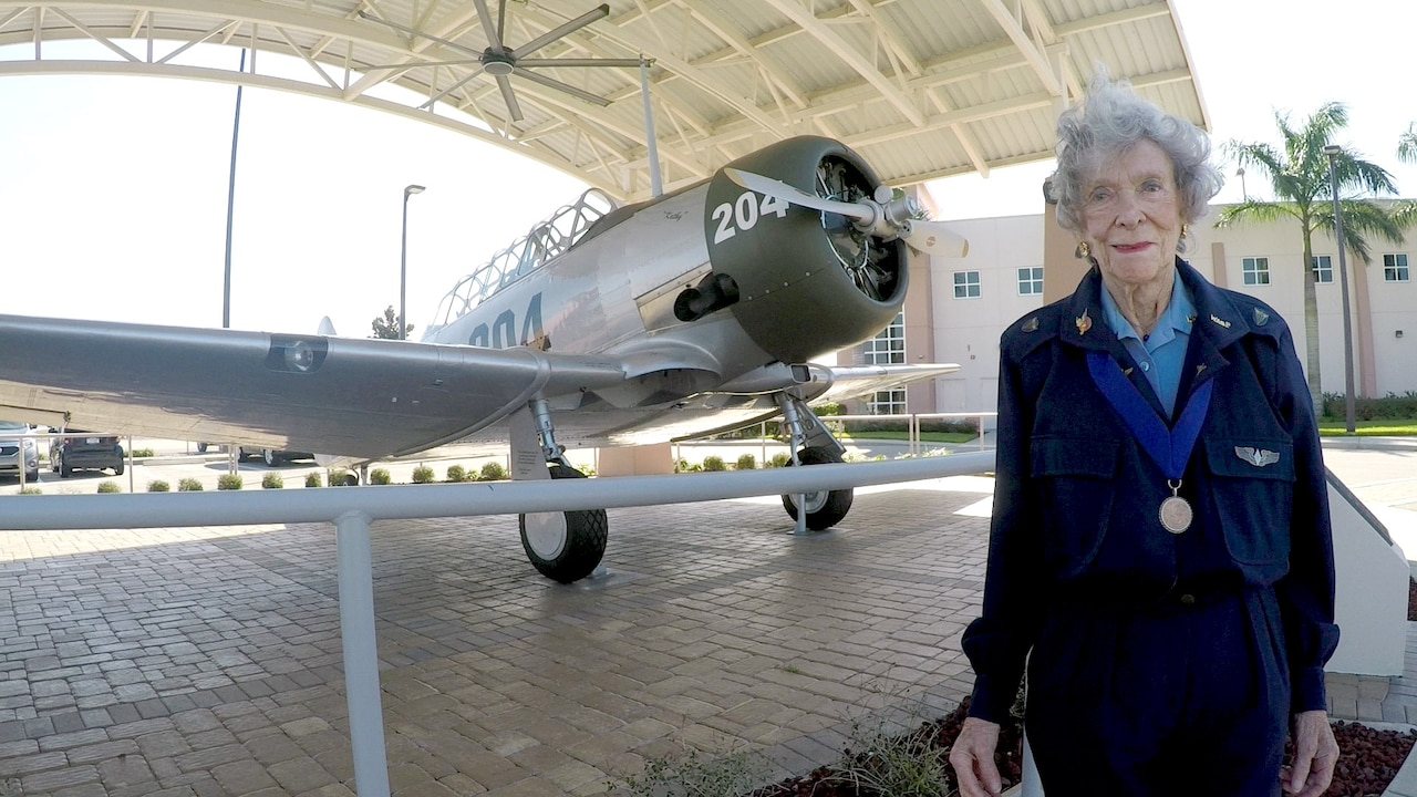 Bernice Haydu, a Women Airforce Service Pilot, or WASP, during World War II, stands next to an AT-6 Texan at Page Field near Fort Myers, Florida, Feb. 20, 2016. The WASPs flew Texans during flight training at Avenger Field in Sweetwater, Texas. DoD photo by Navy Petty Officer 2nd Class Glenn Slaughter