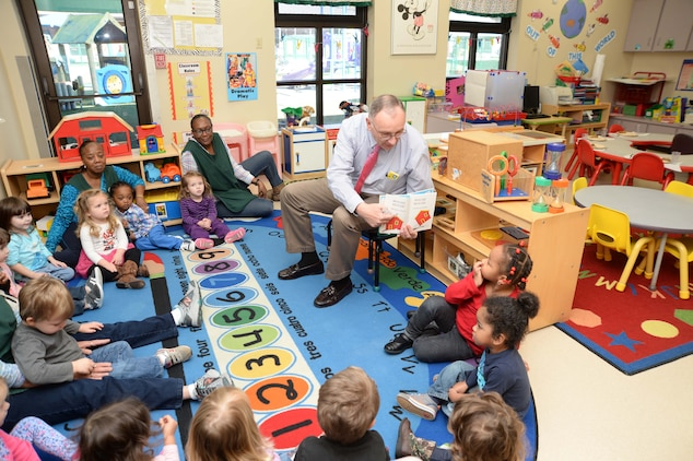 Kent Morrison, executive director, Marine Corps Logistics Base Albany, reads to Pre-K students at the installation's Child Development Center during the annual Read Across America event, recently. The activities are held nationally to celebrate the birthday of author, illustrator Theodor Seuss Geisel, better known as Dr. Seuss.