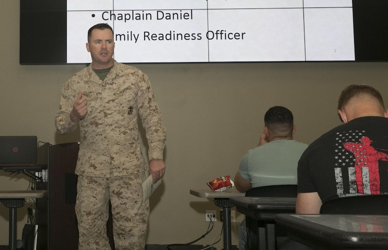 Lt. Col. Christopher Steele, commanding officer, 2nd Battalion, 7th Marine Regiment, talks to the Marines, sailors and their families about the importance of being prepared during the units' pre-deployment brief at building 1707 aboard the Combat Center, March 2, 2016. (Official Marine Corps photo by Thomas Mudd/Released)