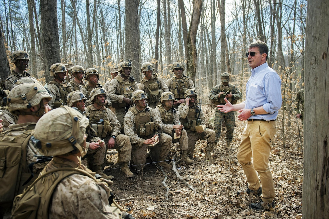 """Defense Secretary Ash Carter speaks to Marines participating in a platoon defense demonstration on Marine Corps Base Quantico, Va., March 9, 2016. Carter visited Quantico to observe Marine Corps training and speak with Marines. DoD photo by Air Force Senior Master Sgt. Adrian Cadiz<br /><br /><a target=""""_blank"""" href=""""https://www.flickr.com/photos/secdef""""> Click here to see more images on Secretary Carter's Flickr page. </a>"""