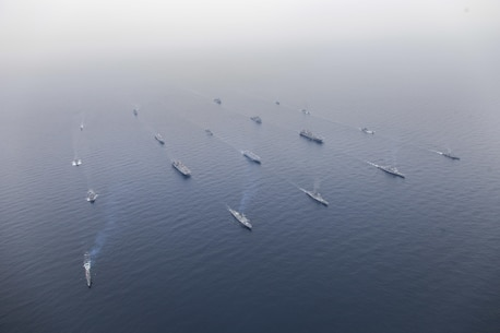 Ships assigned to the Bonhomme Richard and Boxer Expeditionary Strike Groups (BHRESG/BOXESG) along with the Republic of Korea (ROK) Flotilla 5 transit in a formation during a photo exercise commencing exercise Ssang Yong 2016. Sailors and Marines of ROK Navy, Marine Corps, Expeditionary Strike Group (ESG) 7, Commander, Task Force (CTF) 76 and 3rd Marine Expeditionary Brigade (3D MEB), along with 7th ROK Marine Corps Regimental Landing Team 7 (ROKMC RLT-7), Australian Army and Royal New Zealand Army forces are participating in Ssang Yong 2016, the largest combined amphibious exercise of its kind to date, designed to strengthen interoperability and working relationships across a wide range of military operations from disaster relief to complex expeditionary operations. (U.S. Navy photo by Commander, Amphibious Squadron 11, Captain Ed Thompson/Released)