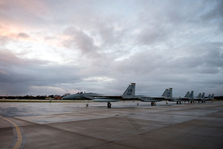 Airmen from the 748th Aircraft Maintenance Squadron perform final checks on F-15C Eagles from the 493rd Fighter Squadron for the next sortie at Royal Air Force Lakenheath, March 7, 2016. The 493rd FS maintains the ability to rapidly generate, deploy, and sustain operations to execute wartime and peacetime taskings in any theater of operations in the world. (U.S. Air Force photo/Airman 1st Class Erin R. Babis)