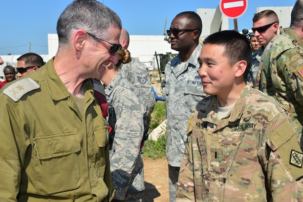 Lt. Gen. William Garrett, U.S. European Command deputy commander, meets 1st Lt. Kyle Kiriyama, 44th Expeditionary Signals Battalion platoon leader, during his visit of the exercise Juniper Cobra. Juniper Cobra is a biennial exercise held in Israel that trains on the ballistic missile defense, crisis resupply, foreign disaster response and foreign humanitarian assistance using computer simulations. Garrett recognized the efforts of three combat communications units working together for the first time in support of the exercise. (U.S. Air Force photo by Staff Sgt. Stephanie Longoria/Released)
