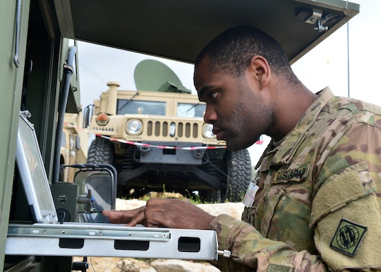 Sgt. Maurice Felder, 44th Expeditionary Signals Battalion Tactical Satellite (TACSAT) team chief, from Grafenwohr, Germany, troubleshoots the satellite connection during exercise Juniper Cobra 16 in Israel, Feb. 22, 2016. Juniper Cobra uses ballistic missile defense computer simulations to train U.S. and Israeli service members while reinforcing a strong military relationship. For the first time, Airmen from the 1st Combat Communications Squadron, 52nd CBCS and soldiers from the 44th Expeditionary Signals Battalion work together to support U.S. European Command. (U.S. Air Force photo by Staff Sgt. Stephanie Longoria/Released)