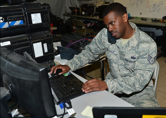 Staff Sgt. Shimir Bishop, 1st Combat Communications Squadron tactical network operations supervisor, from Ramstein Air Base, Germany, modifies a user account during exercise Juniper Cobra 16 in Israel, Feb. 22. Juniper Cobra uses ballistic missile defense computer simulations to train U.S. and Israeli service members while reinforcing a strong military relationship. For the first time, Airmen from the 1st CBCS, 52nd CBCS and soldiers from the 44th Expeditionary Signals Battalion work together to support U.S. European Command. (U.S. Air Force photo by Staff Sgt. Stephanie Longoria/Released)