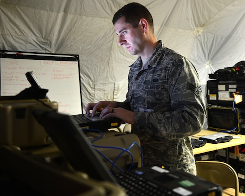 Senior Airman Mitchell Moorehead, 52nd Combat Communications Squadron Radio Frequency transmission specialist, setup communication centers in support of exercise Juniper Cobra 16 in Israel, Jan. 15, 2016. Juniper Cobra uses ballistic missile defense computer simulations to train U.S. and Israeli service members while reinforcing a strong military relationship. For the first time, Airmen from multiple units work together to support U.S. European Command. (U.S. Air Force Staff Sgt. Stephanie Longoria/Released)
