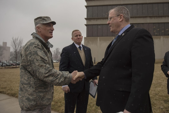 Deputy Defense Secretary Bob Work, right, says goodbye to Air Force Maj. Gen. Thomas J. Tom Masiello, commander, Air Force Research Laboratory as he prepares to depart Wright-Patterson Air Force Base, Ohio, after touring the base and speaking to a group of students from the local Dayton, Ohio, area during a 'Week at the Labs event March 3, 2016. (DoD photo/Air Force Senior Master Sgt. Adrian Cadiz.)