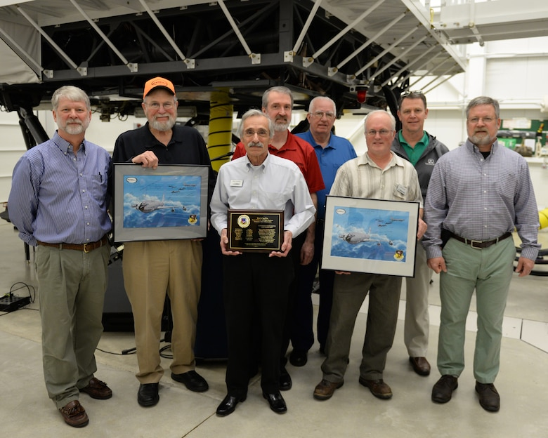 Instructors and technicians from Delaware Resource Group pose for a photograph after the retirement of the KC-135 flight simulator from Pease Air National Guard Base, New Hampshire, March, 9, 2016.  DRG supports the daily operation of the simulator. The simulator is being retired to make way for a new KC-46 weapons trainer slated to arrive in the spring of 2017. (U.S. Air National Guard photo by Staff Sgt. Curtis J. Lenz)