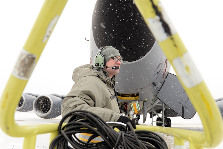 U.S. Air Force Airman 1st Class Alexander Desmarais, a jet engine mechanic assigned to the 157th Maintenance Group, New Hampshire Air National Guard, conducts preflight inspections on a KC-135R Stratotanker during a training exercise, Pease Air National Guard Base, N.H., March. 4, 2016. (U.S. Air National Guard photo by Staff Sgt. Curtis J. Lenz)
