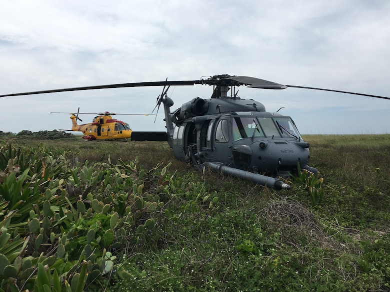 An HH-60 Pave Hawk helicopter and a CH-149 Cormorant helicopter park in the Florida Keys during a U.S.-Canada search-and-rescue exercise March 5, 2016. Rescue Airmen from the 920th Rescue Wing, Patrick Air Force Base, Fla., have been working alongside Canadian search-and-rescue technicians annually for more than a decade. (courtesy photo)