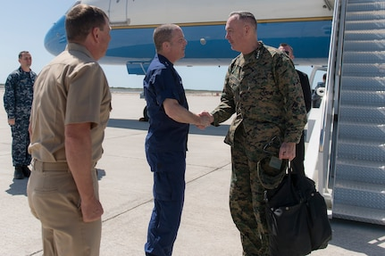 Marine Corps Gen. Joseph F. Dunford Jr., right, chairman of the Joint Chiefs of Staff, exchanges greetings with Coast Guard Rear Adm. Chris Tomney, director of Joint Interagency Task Force South, at Naval Air Station Key West, Fla., March 8, 2016. The task force conducts interagency and international detection and monitoring operations, and facilitates the interdiction of illicit trafficking and other narcoterrorist threats to support national and partner nation security. DoD photo by Navy Petty Officer 2nd Class Dominique A. Pineiro