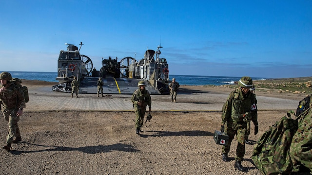 Soldiers with Western Army Infantry Regiment, Japan Ground Self-Defense Force, disembark a landing craft air cushion onto San Clemente Island, California, Feb. 21, 2016, in preparation for the supporting arms coordination center exercise portion of Exercise Iron Fist 2016. Iron Fist is an annual, bilateral amphibious training exercise designed to improve USMC and JGSDF's ability to plan, communicate and conduct combined amphibious operations at the platoon, company and battalion levels.