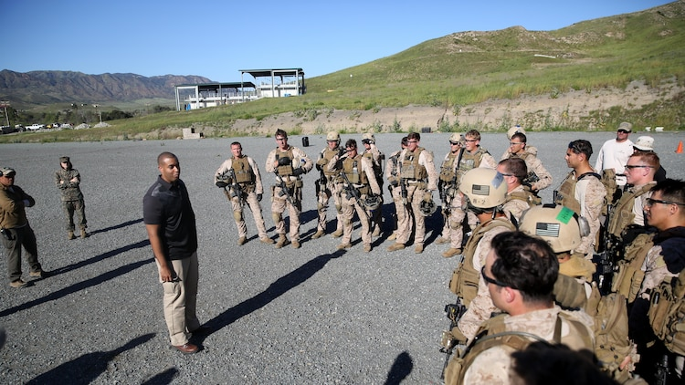 Assistant Secretary of the Navy Honorable Franklin Parker talks with the Marines of Company A, 1st Reconnaissance Battalion, 1st Marine Division, during close quarter battle training at Marine Corps Base Camp Pendleton, California, March 8, 2016. During his visit of the training, Parker observed Marines perform room clearing techniques and close-quarter marksmanship.