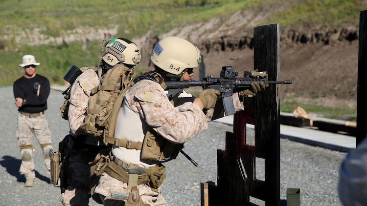 Marines of Company A, 1st Reconnaissance Battalion, 1st Marine Division, conducts target recognition and engagement through a simulated door way during the close quarter marksmanship portion of close quarter battle training at Marine Corps Base Camp Pendleton, California, March 8, 2016. The training focused on room clearing procedures along with close quarter marksmanship in a series of challenging drills.