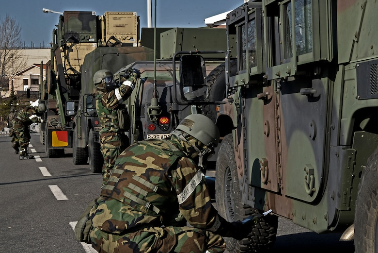 Airmen from the 51st Civil Engineer Squadron chemical, biological, radiological and nuclear reconnaissance team inspect U.S. Army vehicles for possible contamination during Exercise Beverly Midnight 16-01 March 10, 2016, on Osan Air Base, Republic of Korea. Two months of coordination went into making the scenario possible -- a scenario which brought ROK and U.S. soldiers and airmen together. (U.S. Air Force photo by Tech. Sgt. Travis Edwards/Released)