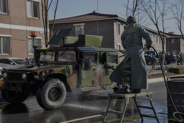 A Republic of Korea army soldier sprays down a U.S. Army Humvee to remove contaminates during a training scenario in Exercise Beverly Midnight 16-01 March 10, 2016, on Osan Air Base, ROK. The scenario ended after the ROK members, who sprayed down the vehicles, then processed through a contamination control point. BM 16-01 is an exercise designed to test the warfighting capabilities of the units assigned to the 51st Fighter Wing with a focus on readiness, defending the base and executing flying operations. (U.S. Air Force photo by Tech. Sgt. Travis Edwards/Released)