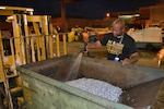 Charles Miller, a Fleet Readiness Center Southeast material identifier, washes a bin of aluminum scraps collected through the manufacturing process. Washing the scraps removes oil residue and dust so the metal can be taken to Defense Logistics Agency Disposition Services for resale. The recycling of metal scraps is one small part of the facility's drive towards decreasing its environmental footprint. Because of such efforts, FRCSE was awarded the CNO's Environmental Award for Sustainability. (U.S. Navy Photo by Clifford Davis/Released)