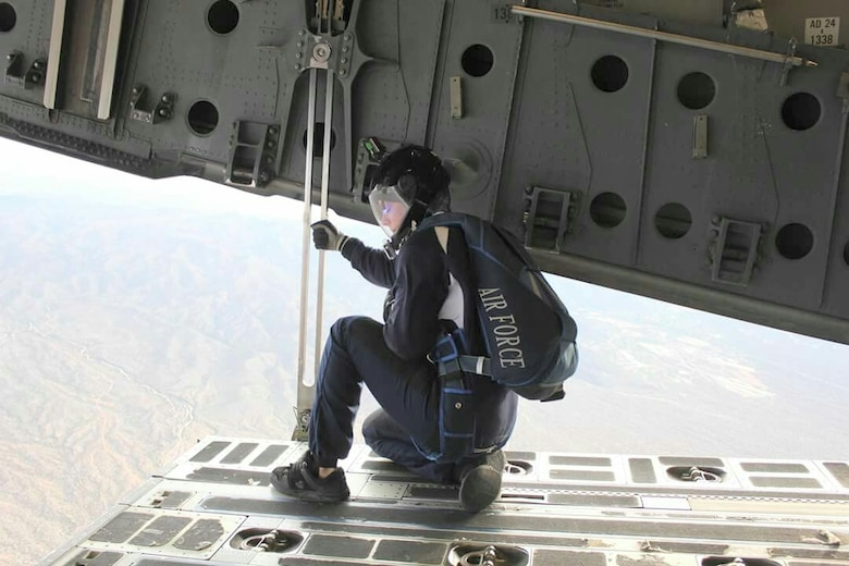 Tech. Sgt. Marcia Regula, an academy military trainer and parachute instructor at the U.S. Air Force Academy, takes a moment before parachuting from an aircraft. At the Academy, Regula teaches competitive free-fall to cadets trying out for the Wings of Blue team. (U.S. Air Force photo)