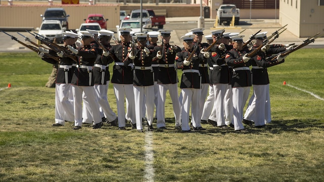 The Marine Corps Silent Drill Platoon of the Battle Color Detachment performs in a Battle Color Ceremony at Marine Corps Air Ground Combat Center Twentynine Palms, California March 9, 2016. The battle color ceremony features the U.S. Marine Drum & Bugle Corps, the Silent Drill Platoon and the Marine Corps Color Guard.