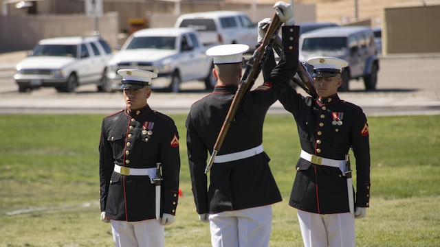 Marines with the Silent Drill Platoon of the Battle Color Detachment prepare to exchange rifles during a Battle Color Ceremony at Marine Corps Air Ground Combat Center Twentynine Palms, California March 9, 2016. The battle color ceremony features the U.S. Marine Drum & Bugle Corps, the Silent Drill Platoon, and the Marine Corps Color Guard.