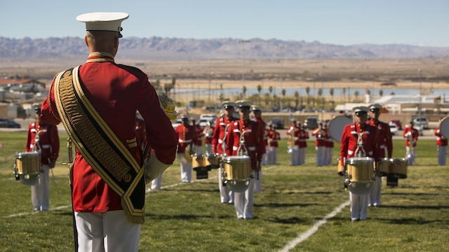 "The U.S. Marine Corps Drum and Bugle Corps, also known as ""The Commandant's Own,"" performs during a Battle Color Ceremony at Marine Corps Air Ground Combat Center Twentynine Palms, California March 9, 2016. The battle color ceremony features the U.S. Marine Drum & Bugle Corps, the Silent Drill Platoon and the Marine Corps Color Guard."