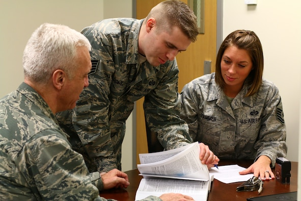 445th Airlift Wing legal office members, Lt. Col, Gregory Baxley, Tech. Sgt. Matthew J. McDonald III and Master Sgt. Rebeccah Stammen, review legal documents during the Feb. 7, 2016 unit training assembly. The wing's legal office helps Airmen with documents like wills, notaries, powers of attorney, and advance medical directives.