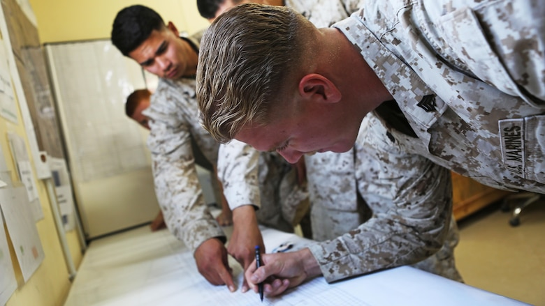 Expeditionary Airfield Service Marines with Marine Wing Support Squadron 372, Special Purpose Marine Air Ground Task Force-Crisis Response-Central Command, mark simulated areas of damage on a runway, during a base recovery after attack drill at an undisclosed location in Southwest Asia, Feb. 22, 2016. The simulation tested  the Marines abilities to immediately  identify, and establish, a minimum operating strip enabling the Aviation Combat Element to quickly takeoff and regain air space superiority. The squadron is currently supporting the Aviation Combat Element with SPMAGTF-CR-CC in support of Operation Inherent Resolve.