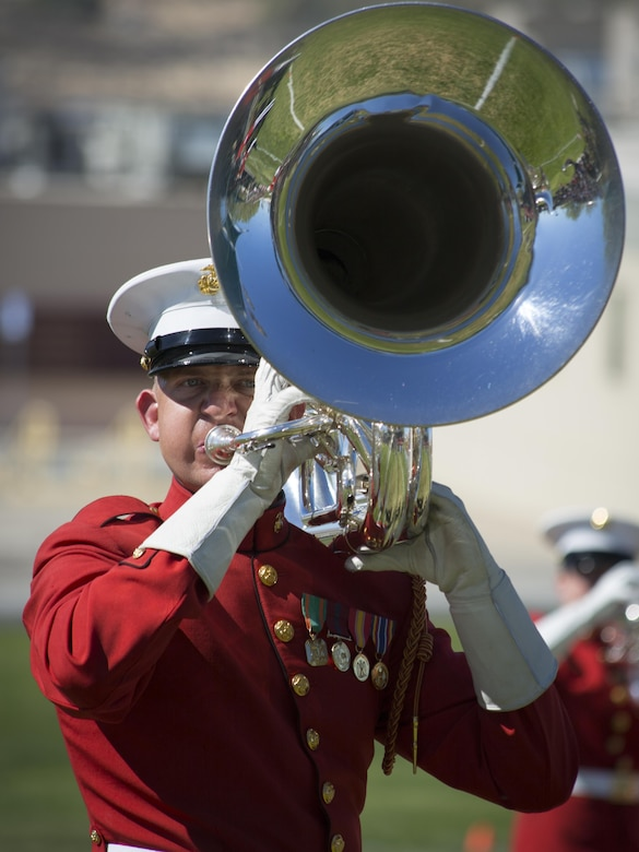 """A Marine with U.S. Marine Drum and Bugle Corps, also known as """"The Commandant's Own,"""" performs during a Battle Color Ceremony at Lance Cpl. Torrey L. Gray Field March 9, 2016. (Official Marine Corps photo by Lance Cpl. Levi Schultz/Released)"""