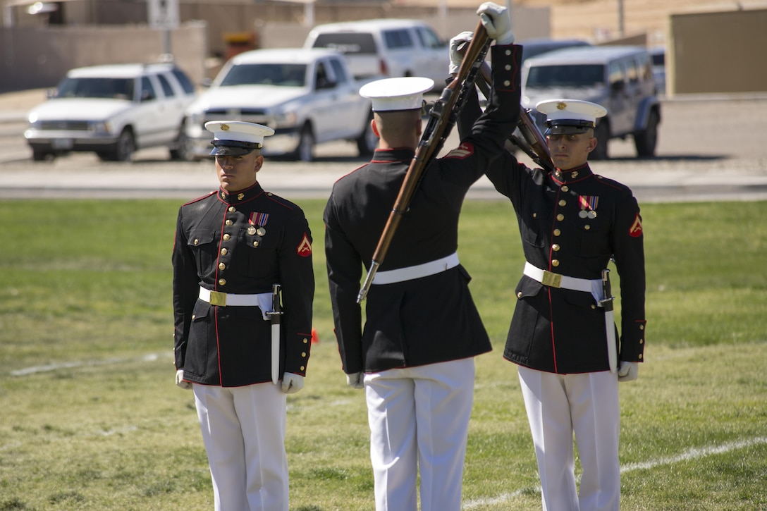 Marines with the Silent Drill Platoon of the Battle Color Detachment prepare to exchange rifles during a Battle Color Ceremony at Lance Cpl. Torrey L. Gray Field March 9, 2016. (Official Marine Corps photo by Lance Cpl. Levi Schultz/Released)