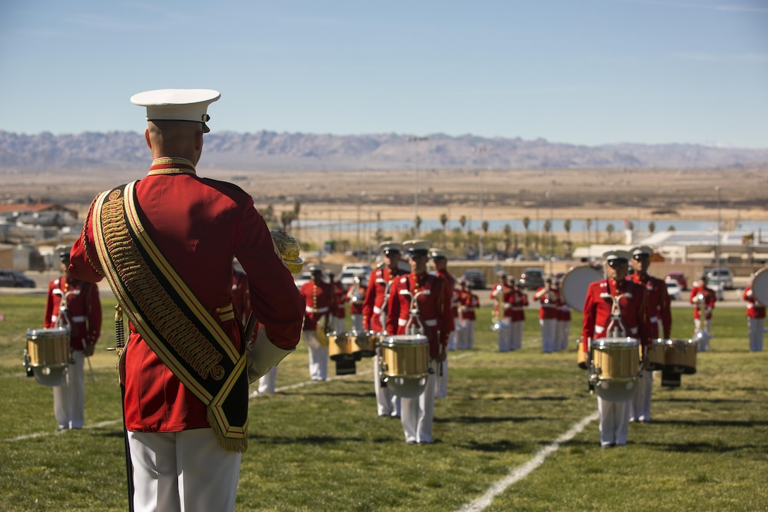 """The U.S. Marine Corps Drum and Bugle Corps, also known as """"The Commandant's Own,"""" performs during a Battle Color Ceremony at Lance Cpl. Torrey L. Gray Field March 9, 2016. (Official Marine Corps photo by Lance Cpl. Levi Schultz/Released)"""