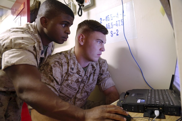 Marines with the 13th Marine Expeditionary Unit set up network communications aboard the USS Boxer during an integration exercise in 2015. The Marine Corps is developing a fully unified command and control construct, integrating cyber and IT capability development processes and streamlining IT acquisition and procurement processes. These improvements will provide more responsive and effective support to the operational force. (U.S. Marine Corps photo by Staff Sgt. Terika S. King)