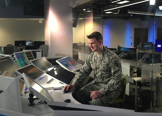"Staff Sgt. Trevor Reiss, a weather forecaster assigned to the 21st Operational Weather Squadron, gets familiar with the technology and computer models used by Weather Channel meteorologists, Feb. 25, 2016, at the Weather Channel studio in Atlanta. Reiss was one of two Airmen from the 557th Weather Wing who was invited to guest star on their show ""Weather Geeks,"" which will air March 13 at noon EST. (U.S. Air Force photo/1st Lt. Carrie Volpe)"