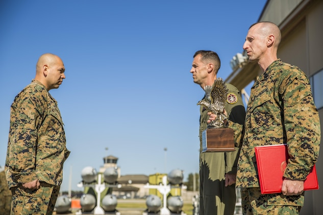 Gunnery Sgt. Carlos Aguilar, left, stands in front of Lt. Col. Harry F. Thomas, center, and Sgt. Maj. Adrian L. Tagliere prior to receiving an award in recognition of his leadership during a ceremony at Marine Fighter Attack Squadron 312 aboard Marine Corps Air Station Beaufort March 2.  During the ceremony, Aguilar was presented with the Navy & Marine Association Leadership Award, a peer-selected recognition. The association sponsors more than 400 awards annually for commanders to recognize officers and enlisted personnel who have been selected by their peers as outstanding leaders in their respective communities. Aguilar is a maintenance controller with VMFA-312. Thomas is the commanding officer of VMFA-312 and Tagliere is the sergeant major of the same unit.
