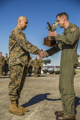 Gunnery Sgt. Carlos Aguilar, left, is presented an award by Lt. Col. Harry F. Thomas, in recognition of his leadership during a ceremony at Marine Fighter Attack Squadron 312 aboard Marine Corps Air Station Beaufort March 2.  During the ceremony, Aguilar was presented with the Navy & Marine Association Leadership Award, a peer-selected recognition. The association sponsors more than 400 awards annually for commanders to recognize officers and enlisted personnel who have been selected by their peers as outstanding leaders in their respective communities. Aguilar is a maintenance controller with VMFA-312. Thomas is the commanding officer of VMFA-312.
