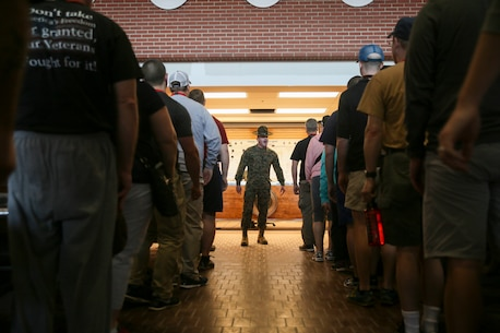 U.S. Marine Corps Sgt. Justin Smith, a drill instructor with Fox Co. 2nd Recruit Training Battalion, explains to educators, during the Educators' Workshop, what recruits experience during their first day on Marine Corps Recruit Depot Parris Island, S.C., March 9, 2016. The educators, from Pennsylvania, New York, and Vermont, were brought to Parris Island to get a small glimpse of what it takes to earn the title United States Marine. (U.S. Marine Corps photo by Sgt. Elizabeth Thurston/Released)