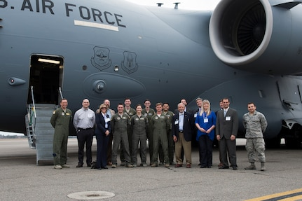 Members of Joint Base Charleston pose for a group photo with newly appointed honorary commanders during the 2016 Honorary Commanders' Orientation Tour, March 9th, 2016 at Joint Base Charleston – Air Base, S.C. The honorary commanders will get to participate in many joint base events over the course of their tenure, giving them a glimpse into some of the challenges and rewards military members face. (U.S. Air Force photo/Staff Sgt. George Goslin)