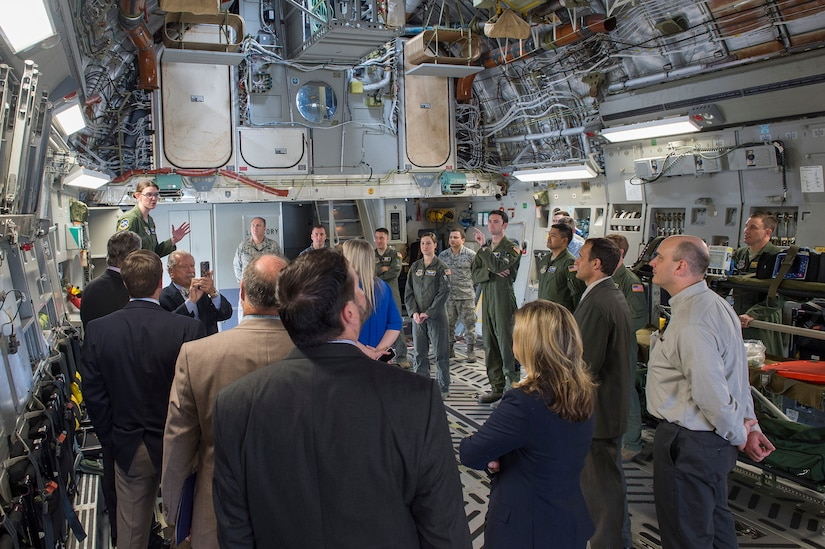 Senior Airman Stephanie Lucas, 14th Airlift Squadron loadmaster, briefs newly appointed honorary commanders on the C-17 Globemaster III's capabilities during the 2016 Honorary Commanders' Orientation Tour, March 9th, 2016 at Joint Base Charleston – Air Base, S.C. The tour provided an opportunity for the new honorary commanders to see first-hand what happens on a military installation, specifically Joint Base Charleston. (U.S. Air Force photo/Staff Sgt. George Goslin)