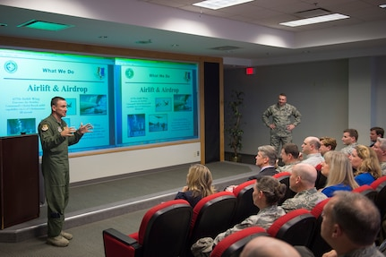 Col. John Lamontagne, 437th Airlift Wing commander, and Col. Rob Lyman, Joint Base Charleston commander, brief newly appointed honorary commanders during the 2016 Honorary Commanders' Orientation Tour, March 9th, 2016 at Joint Base Charleston – Air Base, S.C. The Honorary Commanders program serves as a way to build relations between the military and local community leaders. Fifteen new honorary commanders were selected to join this year. (U.S. Air Force photo/Staff Sgt. George Goslin)